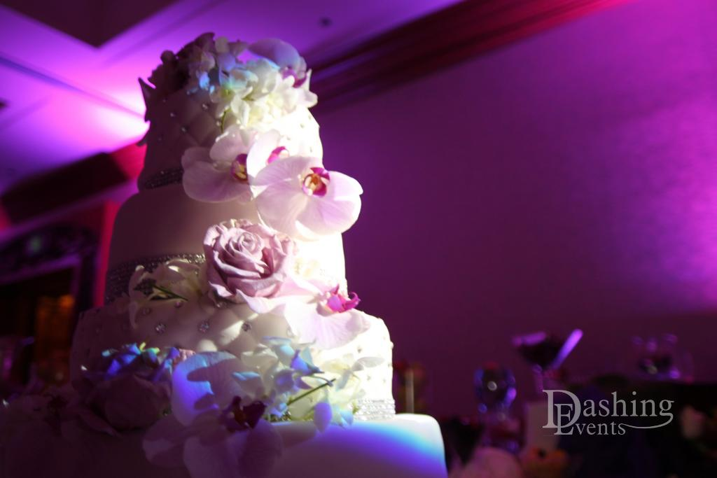 wedding-cake-with-florals-and-lighting.jpg