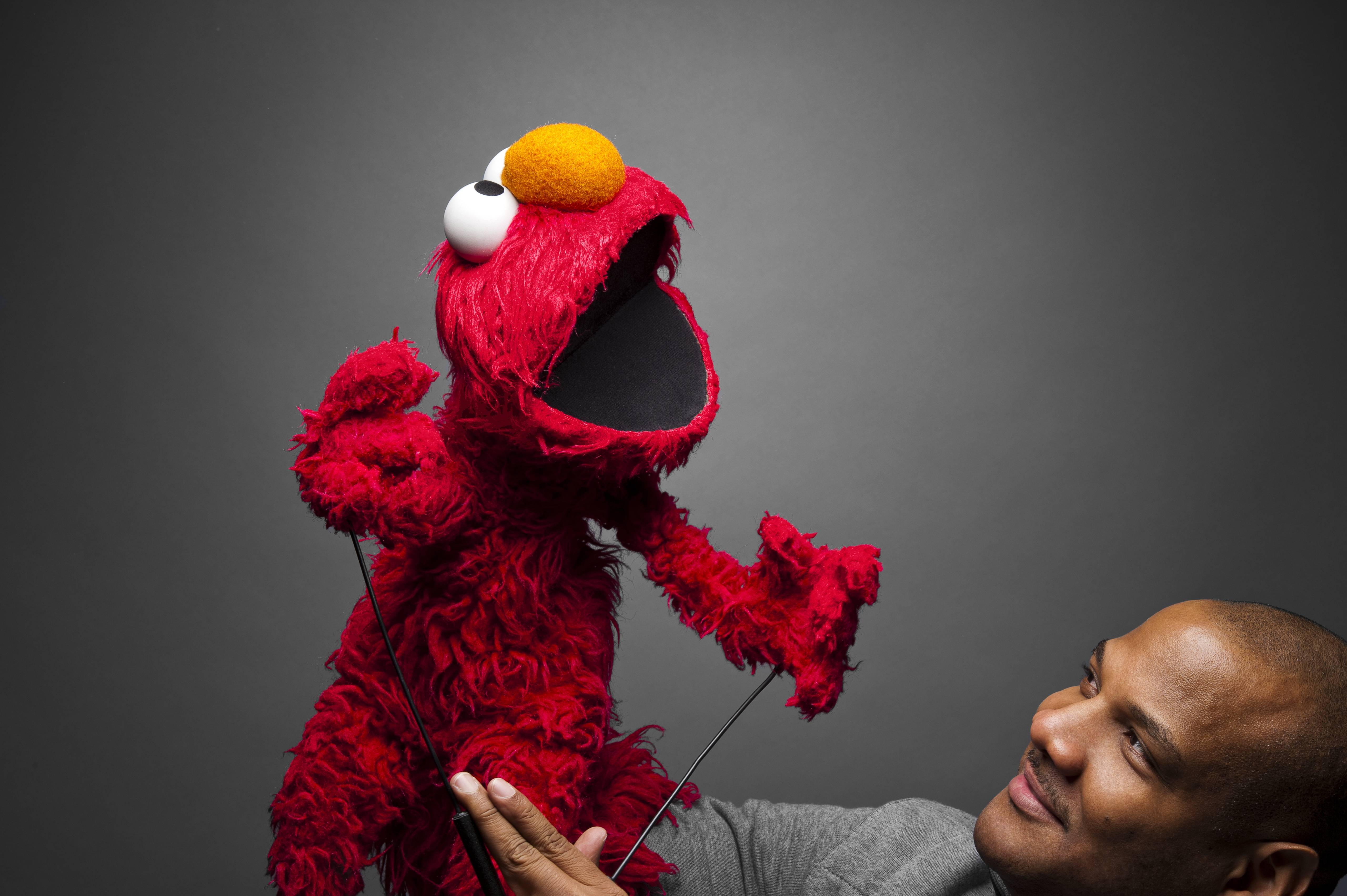 """Elmo and Kevin Clash promoting """"Being Elmo"""" at the Sundance 2011 Moving Pictures Media Studio. Make-up by MAC Cosmetics."""